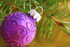 Stock Photo of christmas ball in purple color - closeup