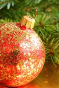 Red christmas glass bauble with golden stars. decoration Stock Photos