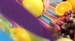 Close up slicing grapefruit in colorful kitchen scene - stock footage