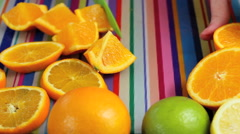 Close up preparing oranges in colorful kitchen - stock footage