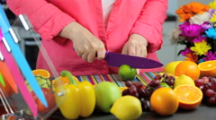 Chopping fruit in colorful kitchen scene Stock Footage