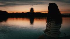 Asian Girl Watching Sunset On Lake Stock Footage