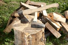 Axe splitting hammer and cut fire wood Stock Photos