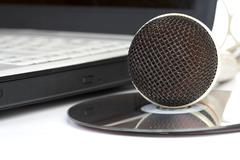the microphone lays on notebook - stock photo