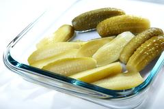 the cut and whole pickles - stock photo