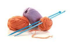 balls of a yarn knitting spokes - stock photo