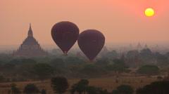 Balloons Floating Over Bagan at Sunrise, Myanmar (Burma) Stock Footage