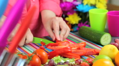 Slicing peppers in colorful contemporary kitchen Stock Footage
