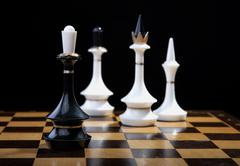 White figures checkmate to king Stock Photos