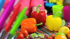 preparing peppers in colorful kitchen scene - stock footage