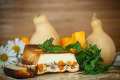 Cottage cheese casserole with slices of pumpkin and nuts Stock Photos