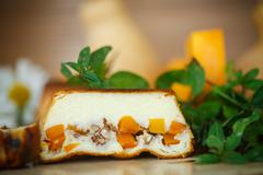 cottage cheese casserole with slices of pumpkin and nuts - stock photo