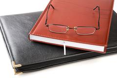 Folder for papers an organizer and glasses isolated Stock Photos