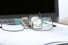 organizer glasses and notebook - stock photo