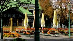 Outdoor seating in the restaurant - autumn - lamp - trees Stock Footage