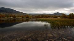 Timelapse 4K lake fall cloudscape rapid moving autumn fall Stock Footage