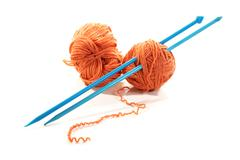 balls of a yarn knitting spokes on white background - stock photo