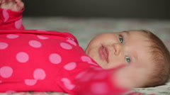Cute three month old baby lying on back Stock Footage
