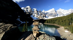 Scenic Landscape Female Hiker Lake Moraine British Columbia Stone Balance Cairn Stock Footage
