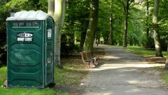 Latrine in the park - forest (trees) with pathway - bench Stock Footage