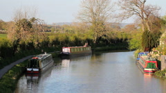 Canal scene with narrowboats and cyclists Stock Footage