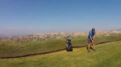GOLFER AERIAL VIEW, VERY LOW ALTITUDE. VER.2 - stock footage