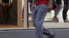Pedestrians are  walking on the sidewalk Stock Footage
