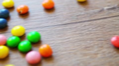 Wooden table with falling candies Stock Footage