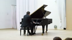 Pianist Vladimir Mishchouk performs at Karelia Philarmony stage Stock Footage