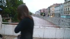 Passersby on Latin bridge in capital bosnian city. Stock Footage