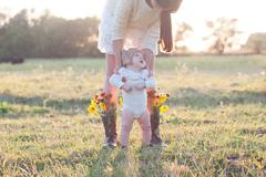 creative portrait of mother and baby in the field - stock photo