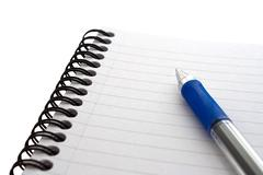 Notepad and pen on isolated white Stock Photos