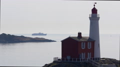 Coho Ferry Passes Fisgard Lighthouse on Vancouver Island, British Columbia Stock Footage