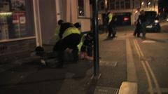 Police Arrest Man on Street Outside Nightclub HD - stock footage