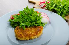 Stock Photo of breaded pork chops in parmesan cheese