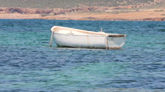 Med Close up White rowing boat bobbing on an azure sea in Cyprus - stock footage