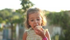 Beautiful girl eating Stock Footage
