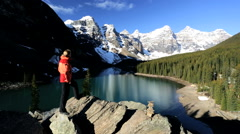 Glacial Valley Blue Water Lake Moraine Female Hiker Remote Forest Hiking Trails - stock footage