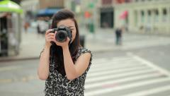 Young Asian Woman taking picture with camera Stock Footage