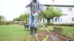 Man gardening in country house Stock Footage