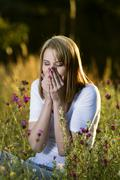 Woman sneezes with allergies Stock Photos