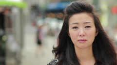 Young Asian Woman in city sad crying face portrait - stock footage