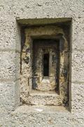 Victorian loophole in stone wall. Stock Photos