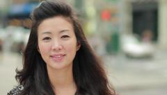 Young Asian Woman smiling happy face in city - stock footage
