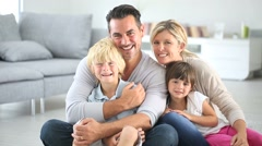 portrait of happy family sitting on floor - stock footage