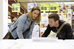 Couple shopping for household appliance - stock photo