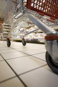 Shopping cart in supermarket, surface level view Kuvituskuvat