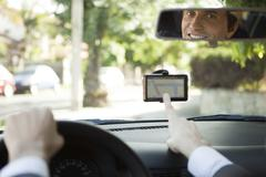 Driver using GPS for navigation assistance Stock Photos