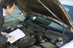 Inspecting car engine Stock Photos