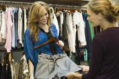 Friends shopping in clothing store - stock photo